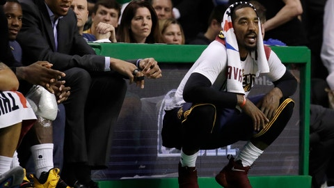 Cleveland Cavaliers guard J.R. Smith, right, shouts encouragement from the sideline during the second half of Game 2 of the NBA basketball Eastern Conference finals against the Boston Celtics, Friday, May 19, 2017, in Boston. (AP Photo/Elise Amendola)