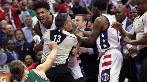 WASHINGTON D.C. - MAY 4: Tempers reach a boiling point as Washington Wizards forward Kelly Oubre Jr. (12) charges and knocks down Boston Celtics center Kelly Olynyk (41) during the second quarter. The Washington Wizards host the Boston Celtics in Game Three of the NBA Eastern Conference Semifinals at the Verizon Center in Washington, D.C. on May 4, 2017. (Photo by Barry Chin/The Boston Globe via Getty Images)
