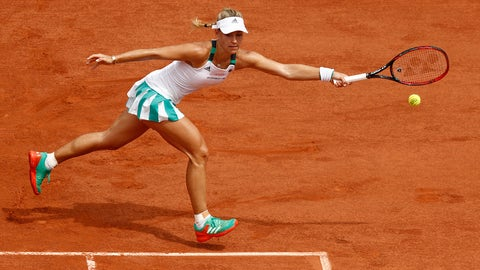 PARIS, FRANCE - MAY 28:  Angelique Kerber of Germany stretches to hit a forehand during the ladies singles first round match against Ekaterina Makarova of Russia on day one of the 2017 French Open at Roland Garros on May 28, 2017 in Paris, France.  (Photo by Adam Pretty/Getty Images)