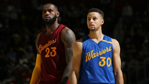 CLEVELAND, OH - DECEMBER 25:  LeBron James #23 of the Cleveland Cavaliers and Stephen Curry #30 of the Golden State Warriors react to a play during the game on December 25, 2016 at Quicken Loans Arena in Cleveland, Ohio. NOTE TO USER: User expressly acknowledges and agrees that, by downloading and/or using this Photograph, user is consenting to the terms and conditions of the Getty Images License Agreement. Mandatory Copyright Notice: Copyright 2016 NBAE  (Photo by David Sherman/NBAE via Getty Images)