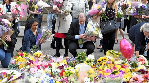 MANCHESTER, ENGLAND - MAY 24:  Manchester City Council workers move the floral tributes from Albert Square to St Anns Square on May 24, 2017 in Manchester, England. An explosion occurred at Manchester Arena on the evening of May 22 as concert goers were leaving the venue after Ariana Grande had performed. Greater Manchester Police are treating the explosion as a terrorist attack and have confirmed 22 fatalities and 59 injured.  (Photo by Jeff J Mitchell/Getty Images)