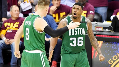 CLEVELAND, OH - MAY 21:  Marcus Smart #36 celebrates with Jonas Jerebko #8 of the Boston Celtics after their 111 to 108 win over the Cleveland Cavaliers during Game Three of the 2017 NBA Eastern Conference Finals at Quicken Loans Arena on May 21, 2017 in Cleveland, Ohio. NOTE TO USER: User expressly acknowledges and agrees that, by downloading and or using this photograph, User is consenting to the terms and conditions of the Getty Images License Agreement.  (Photo by Jamie Sabau/Getty Images)