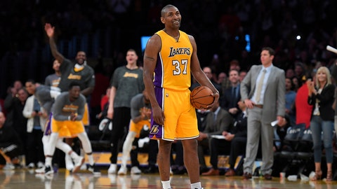 Los Angeles Lakers forward Metta World Peace stands on the court while teammates and fans cheer as the 24 second clock runs out near the end of the team's  NBA basketball game against the New Orleans Pelicans, Tuesday, April 11, 2017, in Los Angeles. The Lakers won 108-96. (AP Photo/Mark J. Terrill)