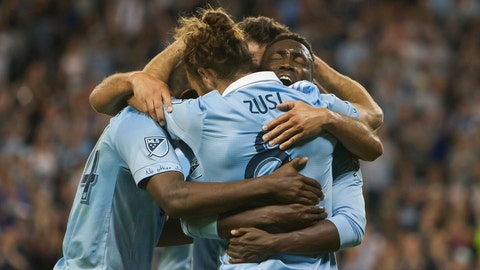 Sporting Kansas City forward Gerso Fernandes, mostly obscured, is surrounded by teammates after scoring his third goal against the Seattle Sounders during an MLS soccer match Wednesday, May 17, 2017, in Kansas City, Kan. (Nick Tre. Smith/The Kansas City Star via AP)
