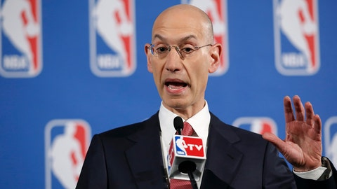 FILE - In this May 20, 2014, file photo, NBA Commissioner Adam Silver gestures during a press conference before the NBA draft lottery in New York. Thanks to a $24 billion television deal that kicks in before the 2016-17 season, already skyrocketing salaries will soon reach a new stratosphere. (AP Photo/Kathy Willens, File)