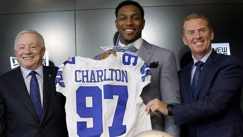 The Dallas Cowboys No. 1 draft pick defensive end Taco Charlton, center, poses for a photos with team owner Jerry Jones, left, and head coach Jason Garret during a news conference at the team's football headquarters in Frisco, Texas, Friday, April 28, 2017. (AP Photo/LM Otero)