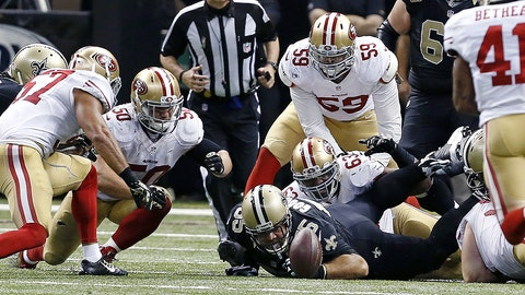 New Orleans Saints center Jonathan Goodwin (55) watches as players converge on a Drew Brees fumble, which was recovered by the San Francisco 49ers, in overtime of an NFL football game in New Orleans, Sunday, Nov. 9, 2014. The 49ers won 27-24. (AP Photo/Jonathan Bachman)