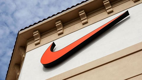 "ORLANDO, FL - DECEMBER 12:  The  ""Swoosh"" logo is seen on a Nike factory store on December 12, 2009 in Orlando, Florida. Tiger Woods announced that he will take an indefinite break from professional golf to concentrate on repairing family relations after admitting to infidelity in his marriage. The company issued a statement that ""Woods and his family have Nike's full support."" (Photo by Getty Images)"