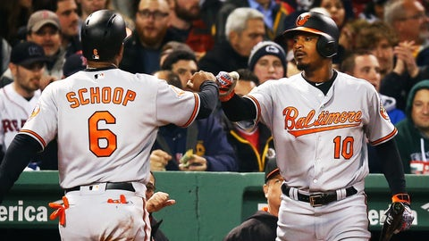 BOSTON, MA - MAY 01: Jonathan Schoop #6 high fives Adam Jones #10 of the Baltmore Orioles after scoring in the fifth inning of a game against the Boston Red Sox at Fenway Park on May 1, 2017 in Boston, Massachusetts.  (Photo by Adam Glanzman/Getty Images)