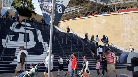 Fans enter PetCo Park before a baseball game between the San Diego Padres and San Francisco Giants in San Diego, Friday, April 7, 2017. (AP Photo/Alex Gallardo)