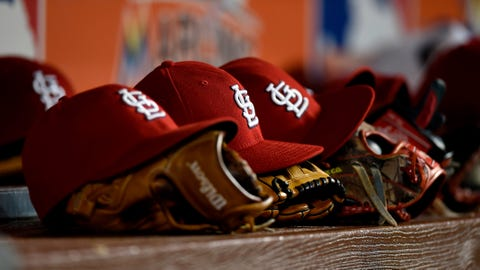 May 10, 2017; Miami, FL, USA; A row of St. Louis Cardinals baseball cap and gloves are seen in the dugout during the fourth inning against the Miami Marlins at Marlins Park. Mandatory Credit: Steve Mitchell-USA TODAY Sports