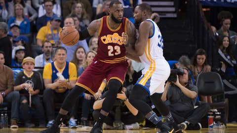 January 16, 2017; Oakland, CA, USA; Cleveland Cavaliers forward LeBron James (23) dribbles the basketball against Golden State Warriors forward Kevin Durant (35) during the third quarter at Oracle Arena. The Warriors defeated the Cavaliers 126-91. Mandatory Credit: Kyle Terada-USA TODAY Sports