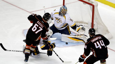 Nashville Predators goalie Pekka Rinne (35) blocks a shot by Anaheim Ducks' Rickard Rakell (67) during the third period of Game 2 of the Western Conference final in the NHL hockey Stanley Cup playoffs, Sunday, May 14, 2017, in Anaheim, Calif. (AP Photo/Chris Carlson)