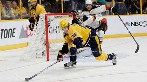 Nashville Predators left wing Pontus Aberg (46), of Sweden, chases the puck in front of the Anaheim Ducks net during overtime of Game 4 of the Western Conference final in the NHL hockey Stanley Cup playoffs Thursday, May 18, 2017, in Nashville, Tenn. (AP Photo/Mark Humphrey)