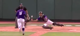 College catcher makes acrobatic grab after ball bounces off his mask and arm