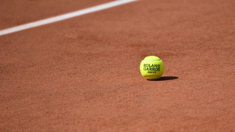 PARIS, FRANCE - MAY 23:  A general view of a Roland Garros tennis ball on the clay before the start of the 2017 French Open at Roland Garros on May 23, 2017 in Paris, France.  (Photo by Aurelien Meunier/Getty Images)