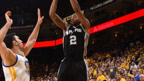 OAKLAND, CA - MAY 14: Kawhi Leonard #2 of the San Antonio Spurs shoots the ball against the Golden State Warriors in Game One of the Western Conference Finals of the 2017 NBA Playoffs on May 14, 2017 at ORACLE Arena in Oakland, California. NOTE TO USER: User expressly acknowledges and agrees that, by downloading and/or using this Photograph, user is consenting to the terms and conditions of the Getty Images License Agreement. Mandatory Copyright Notice: Copyright 2017 NBAE (Photo by Andrew D. Bernstein/NBAE via Getty Images)