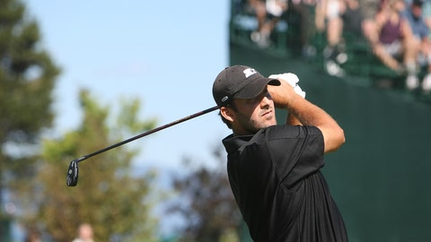 Dallas Cowboys quarterback Tony Romo tees off on the first hole at Edgewood Tahoe Golf Course during the American Century Championship golf tournament in Stateline, Nev. on Saturday, July 21, 2012. (AP Photo/The Tahoe Tribune, Joe Proudman)