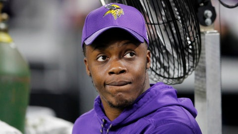 Injured Minnesota Vikings quarterback Teddy Bridgewater sits on the bench before an NFL football game against Dallas Cowboys Thursday, Dec. 1, 2016, in Minneapolis. (AP Photo/Andy Clayton-King)