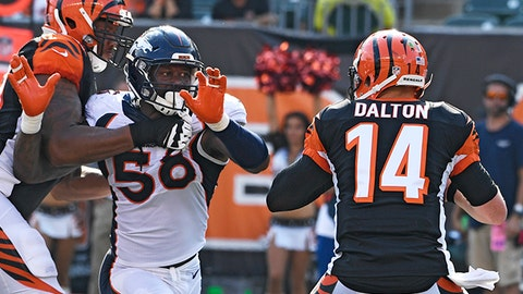 CINCINNATI, OH - SEPTEMBER 25: Denver Broncos outside linebacker Von Miller (58) has his eye on on Cincinnati Bengals quarterback Andy Dalton (14) during the fourth quarter but is held by Cincinnati Bengals offensive tackle Cedric Ogbuehi (70) on the play September 25, 2016 at Paul Brown Stadium. (Photo By John Leyba/The Denver Post via Getty Images)