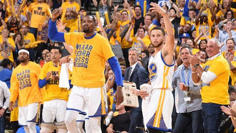 OAKLAND, CA - MAY 2:  Kevin Durant #35 and Stephen Curry #30 of the Golden State Warriors celebrate during Game One of the Western Conference Semifinals of the 2017 NBA Playoffs on May 2, 2017 at ORACLE Arena in Oakland, California. NOTE TO USER: User expressly acknowledges and agrees that, by downloading and/or using this photograph, user is consenting to the terms and conditions of Getty Images License Agreement. Mandatory Copyright Notice: Copyright 2017 NBAE (Photo by Andrew D. Bernstein/NBAE via Getty Images)