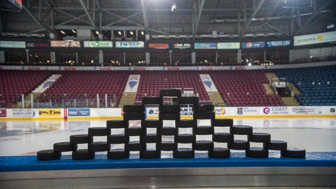 KELOWNA, CANADA - NOVEMBER 21: Stacked pucks form a pyramid on the bench prior to warm up between the Kelowna Rockets and the Portland Winterhawks  on November 21, 2014 at Prospera Place in Kelowna, British Columbia, Canada.  (Photo by Marissa Baecker/Getty Images)