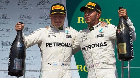 (From left) Valtteri Bottas and Lewis Hamilton celebrate on the podium. (Photo: Steve Etherington/LAT Images)
