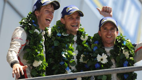 Timo Bernhard, Earl Bamber and Brendon Hartley celebrate their victory. (Photo: LAT Images)