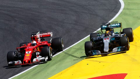 Sebastian Vettel and Lewis Hamilton pictured going wheel-to-wheel at the Spanish GP. (Photo: Andy Hone/LAT Images)