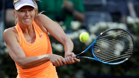 Maria Sharapova, of Russia, returns the ball to Mirjana Lucic-Baroni, of Croatia, during the Italian Open tennis tournament, in Rome, Tuesday, May 16, 2017. (AP Photo/Andrew Medichini)