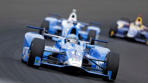 Tony Kanaan, of Brazil, drives through the first turn during the running of the Indianapolis 500 auto race at Indianapolis Motor Speedway, Sunday, May 28, 2017, in Indianapolis. (AP Photo/Darron Cummings)