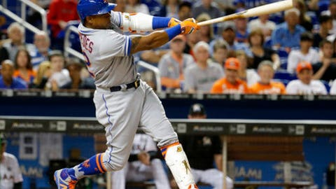 FILE - In this April 13, 2017, file photo, New York Mets' Yoenis Cespedes hits a home run during the third inning of a baseball game against the Miami Marlins in Miami. Mets general manager Sandy Alderson says the team hopes Cespedes will be ready to come off the disabled list in a week to 10 days, perhaps in time to be the designated hitter during a two-game series at Texas that begins June 6. (AP Photo/Lynne Sladky, File)