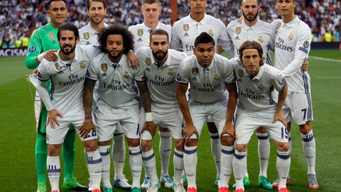 FILE - In this May 2, 2017.file photo, Real Madrid players pose for a photo ahead of the Champions League semifinal first leg soccer match between Real Madrid and Atletico Madrid at the Santiago Bernabeu stadium in Madrid, Spain. Real Madrid meet Juventus in the Champions League final in Cardiff on Saturday June 3, 2017. (AP Photo/Francisco Seco, File)