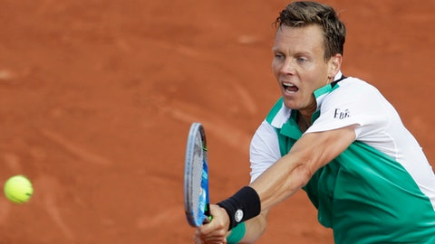 Tomas Berdych of the Czech Republic plays a shot against Germany's Jan-Lennard Struff during their first round match of the French Open tennis tournament at the Roland Garros stadium, in Paris, France. Tuesday, May 30, 2017. (AP Photo/Petr David Josek)