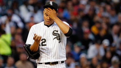 Chicago White Sox starting pitcher Jose Quintana wipes his face during the second inning of a baseball game against the Boston Red Sox Tuesday, May 30, 2017, in Chicago. (AP Photo/Charles Rex Arbogast)
