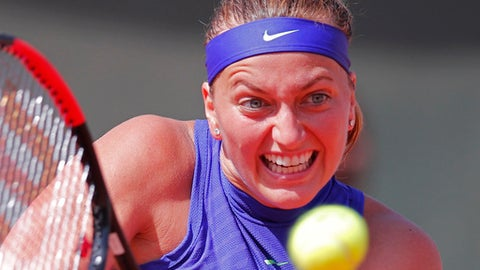 Petra Kvitova of the Czech Republic plays a shot against Bethanie Mattek-Sands of the U.S. during their second round match of the French Open tennis tournament at the Roland Garros stadium, in Paris, France. Wednesday, May 31, 2017. (AP Photo/Christophe Ena)