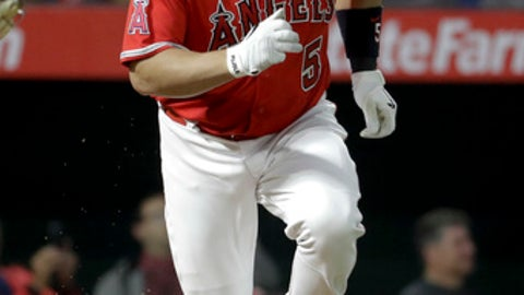 Los Angeles Angels' Albert Pujols watches his single to shallow center during the fourth inning of the team's baseball game against the Atlanta Braves in Anaheim, Calif., Wednesday, May 31, 2017. (AP Photo/Chris Carlson)