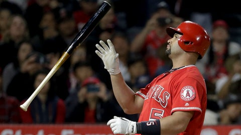 Los Angeles Angels' Albert Pujols tosses his bat after striking out against the Atlanta Braves during the eighth inning of a baseball game in Anaheim, Calif., Wednesday, May 31, 2017. (AP Photo/Chris Carlson)