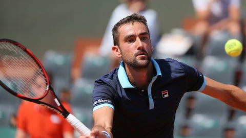Croatia's Marin Cilic plays a shot against Russia's Konstantin Kravchuk during their second round match of the French Open tennis tournament at the Roland Garros stadium, in Paris, France. Thursday, June 1, 2017. (AP Photo/David Vincent)