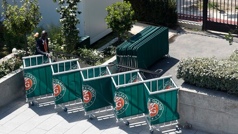 A security officer stands by security fences during the French Open tennis tournament at the Roland Garros stadium, Thursday, June 1, 2017 in Paris. (AP Photo/Petr David Josek)