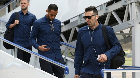 Juventus goalkeeper Gianluigi Buffon, right, arrives with his teammates in Cardiff, Wales, Friday June 2, 2017. Real Madrid will play Juventus in the final of the Champions League soccer match in Cardiff on Saturday. (UEFA Pool via AP)