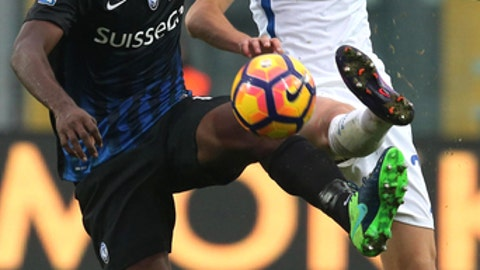 FILE - In this Sunday, Oct. 23, 2016 file photo, Atalanta's Franck Kessie, left, and Inter Milan's Marcelo Brozovic vie for the ball during a Serie A soccer match in Bergamo, Italy. AC Milan has acquired Ivory Coast midfielder Franck Kessie on a two-year loan from Atalanta, as the Rossoneri attempt to make a big impact in the transfer market. (Paolo Magni/ANSA via AP)
