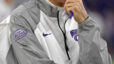FILE - In this Dec. 28, 2016, file photo, Kansas State coach Bill Snyder watches his team warm up for the Texas Bowl NCAA college football game against Texas A&M, in Houston. Hall of Fame coach Bill Snyder has been diagnosed with throat cancer, though treatments are going well and he says in a statement that he expects to be on the field for spring practice in March. The 77-year-old Snyder addressed his health in a statement Monday, Feb. 13, 2017, after rumors began circling that he was seeking treatment for an undisclosed illness.(AP Photo/Eric Christian Smith)