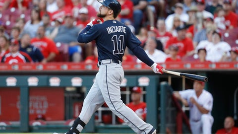 Atlanta Braves' Ender Inciarte watches an RBI sacrifice fly off Cincinnati Reds starting pitcher Bronson Arroyo during the third inning of a baseball game, Friday, June 2, 2017, in Cincinnati. (AP Photo/John Minchillo)