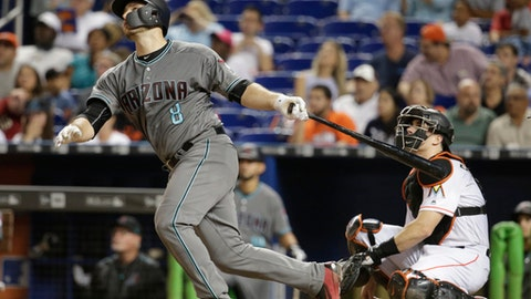 Arizona Diamondbacks' Chris Iannetta (8) watches jos solo home run during the fifth inning of a baseball game against the Miami Marlins, Friday, June 2, 2017, in Miami. At right is Marlins catcher J.T. Realmuto. (AP Photo/Lynne Sladky)