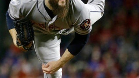 Houston Astros starting pitcher Dallas Keuchel kicks while throwing during the first inning of a baseball game against the Texas Rangers in Arlington, Texas, Friday, June 2, 2017. (AP Photo/LM Otero)