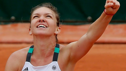Romania's Simona Halep raises her fist as she defeats Russia's Daria Kasatkina during their third round match of the French Open tennis tournament at the Roland Garros stadium, Saturday, June 3, 2017 in Paris. Halep won 6-0, 7-5. (AP Photo/Michel Euler)