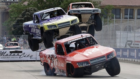 Arie Luyendyk Jr., leads Gavin Harlan during the SPEED Energy Stadium Super Truck series race on Belle Isle, Saturday, June 3, 2017 for the first race of the IndyCar Detroit Grand Prix auto racing doubleheader in Detroit. (AP Photo/Carlos Osorio)