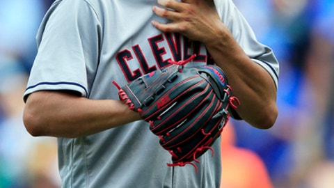 Cleveland Indians starting pitcher Carlos Carrasco wipes his face as he leaves during the fifth inning of a baseball game against the Kansas City Royals at Kauffman Stadium in Kansas City, Mo., Saturday, June 3, 2017. Carrasco gave up six runs in the inning. (AP Photo/Orlin Wagner)