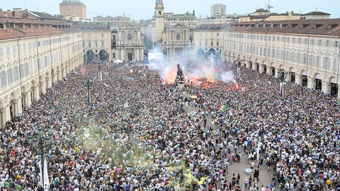 Juventus' fans gather in San Carlo's square to watch on a giant screen the Champions League final soccer match between Juventus and Real Madrid, in Turin, Italy, Saturday, June 3, 2017. (Alessandro Di Marco/ANSA via AP)
